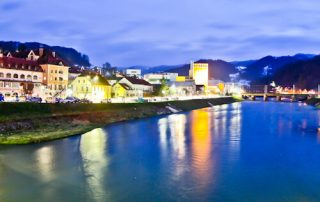 the old town of Lasko reflecting in the Savinja river, Slovenia