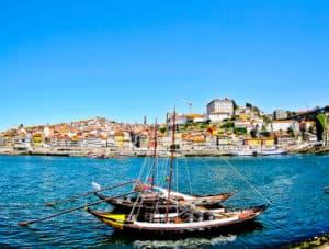 Port barrels in boats on the Douro River, Porto