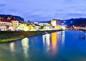 the old town of Lasko reflecting in the Savinja river, Slovenia