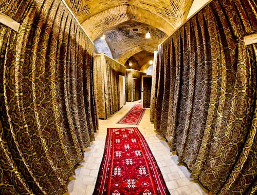 Stay in a caravanserai on the silk road - Zeinodin Caravanserai, Iran - Instagram worthy corridors